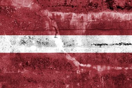disintegrate: Latvia Flag painted on grunge wall Stock Photo