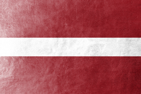 Latvia Flag painted on leather texture photo