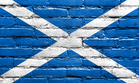 Scotland Flag painted on brick wall photo