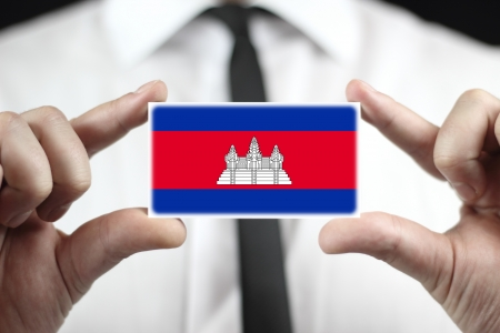 cambodian flag: Businessman holding a business card with Cambodia Flag
