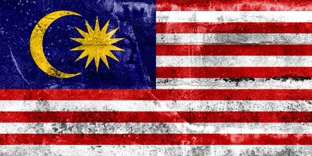 Malaysia Flag painted on grunge wall photo