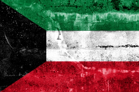 disintegrate: Kuwait Flag painted on grunge wall