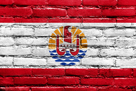 French Polynesia Flag painted on brick wall