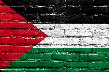 Palestine Flag painted on brick wall photo