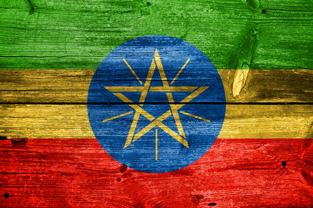 ethiopia abstract: Ethiopia Flag painted on old wood plank texture Stock Photo