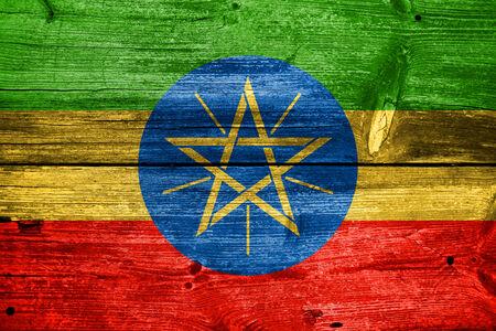 ethiopia flag: Ethiopia Flag painted on old wood plank texture Stock Photo