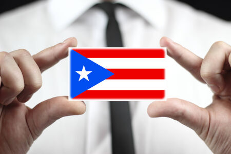 Businessman holding a business card with Puerto Rico Flag