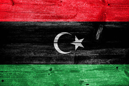Libya Flag painted on old wood plank texture photo