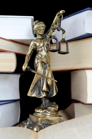 Justice Statue and book. Lawyer background
