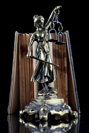 justice statue: Justice Statue and old book. Lawyer background