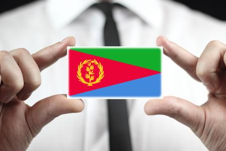 eritrea: Businessman holding a business card with Eritrea Flag Stock Photo