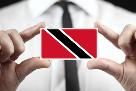 trinidad: Businessman holding a business card with Trinidad and Tobago Flag Stock Photo
