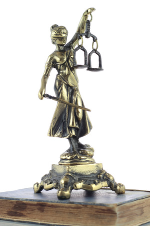 Justice Statue and old book. Lawyer background photo