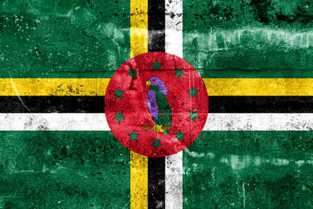 disintegrate: Dominica Flag painted on grunge wall