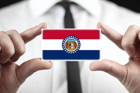 Businessman holding a business card with Missouri State Flag