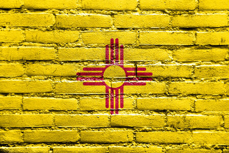 solid state: New Mexico State Flag painted on brick wall