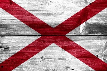 Alabama State Flag painted on old wood plank texture