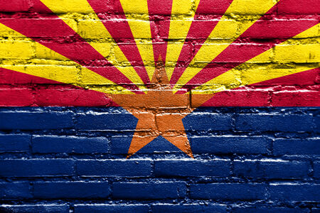 u.s. flag: Arizona State Flag painted on brick wall