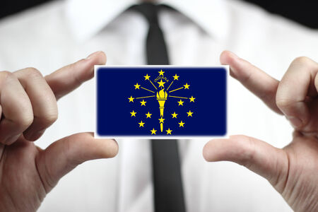 Businessman holding a business card with Indiana State Flag Stock Photo