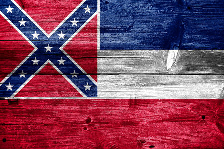Mississippi State Flag painted on old wood plank texture photo