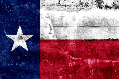 yıldız: Texas State Bayrak grunge duvar boyalı Stok Fotoğraf