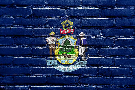 brick and mortar: Maine State Flag painted on brick wall Stock Photo