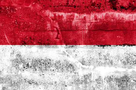Indonesia Flag painted on grunge wall photo