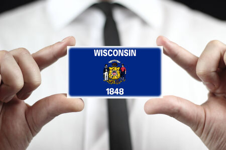 patiotic: Businessman holding a business card with Wisconsin State Flag
