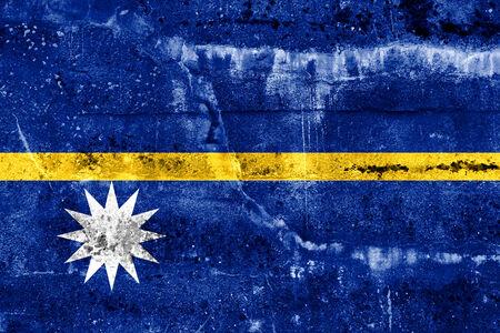disintegrate: Nauru Flag painted on grunge wall Stock Photo