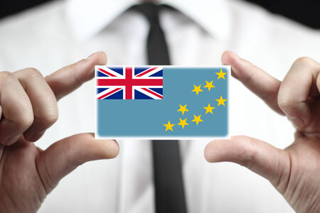 tuvalu: Businessman holding a business card with Tuvalu Flag