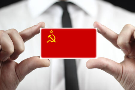 Businessman holding a business card with USSR Flag photo