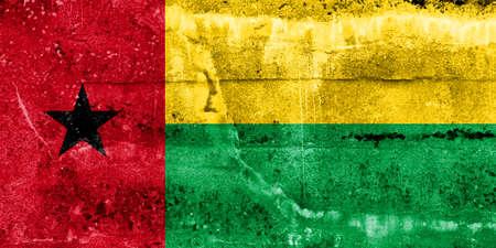 guinea bissau: Guinea Bissau Flag painted on grunge wall