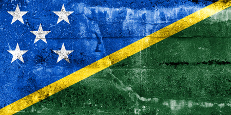 disintegrate: Solomon Islands Flag painted on grunge wall Stock Photo