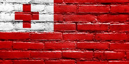 proportional: Tonga Flag painted on brick wall Stock Photo
