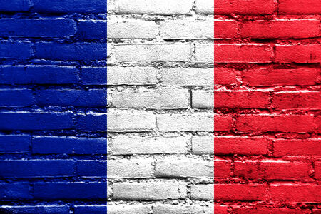 France Flag painted on brick wall photo