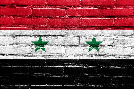brick and mortar: Syria Flag painted on brick wall