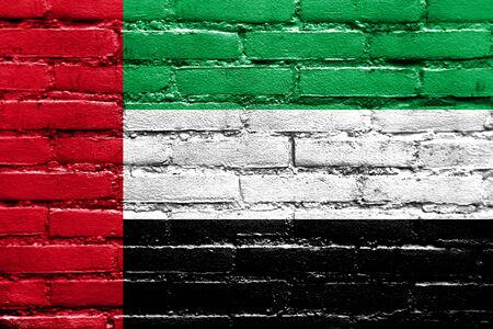 brick and mortar: United Arab Emirates Flag painted on brick wall