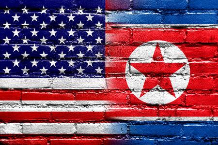 USA and North Korea Flag painted on brick wall photo