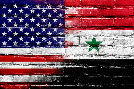 USA and Syria Flag painted on brick wall photo