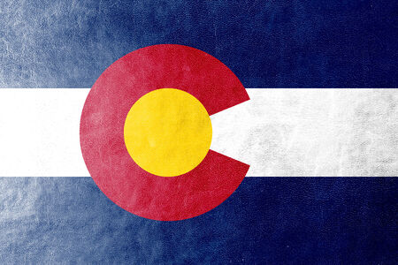 colorado mountains: Colorado State Flag painted on leather texture