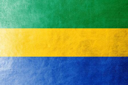 gabon: Gabon Flag painted on leather texture Stock Photo