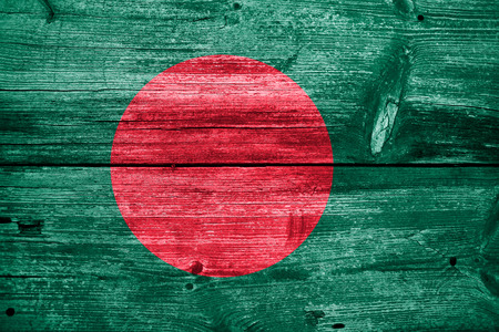 Bangladesh Flag painted on old wood plank texture photo