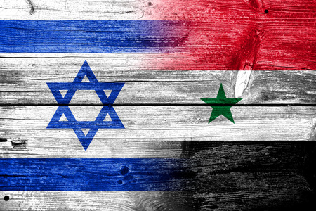 Israel and Syria Flag painted on old wood plank texture photo