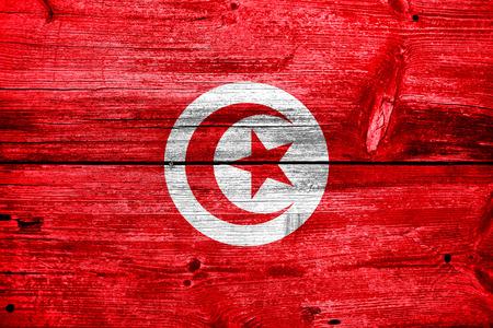 Tunisia Flag painted on old wood plank texture photo
