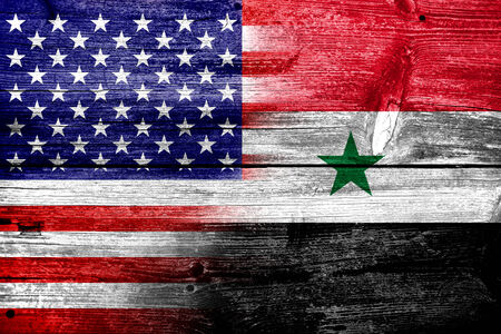 USA and Syria Flag painted on old wood plank texture photo