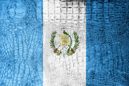 Guatemala Flag painted on luxury crocodile texture photo