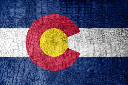 colorado mountains: Colorado State Flag painted on luxury crocodile texture Stock Photo