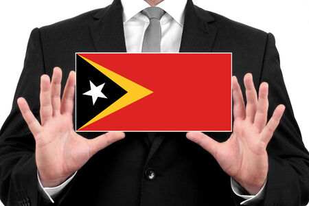 timor: Businessman holding a business card with East Timor Flag