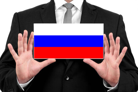 Businessman holding a business card with Russia Flag photo