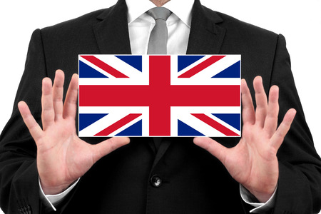 Businessman holding a business card with UK Flag photo